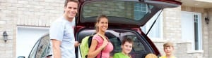 Happy family in front of their new car auto insurance agency